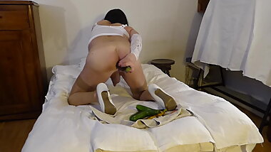 Tgirl Scarlette takes an aubergine in vegetable sex