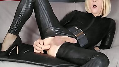 Crossdresser Faustine Vinyl Catsuit Assfucked with Dildo